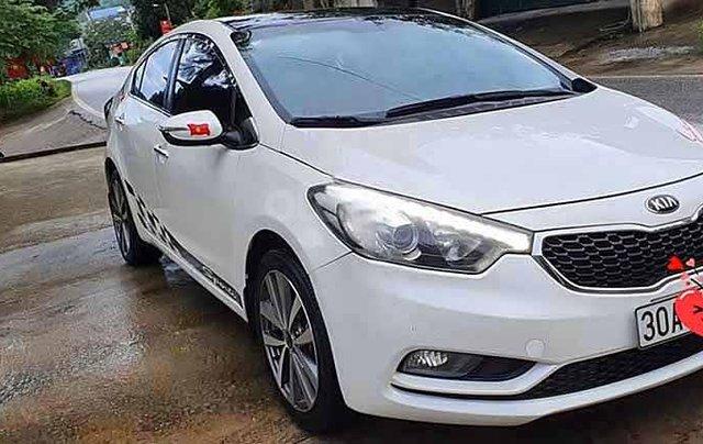 Cần bán xe Kia K3 sản xuất năm 2015, màu trắng, số tự động0