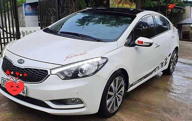 Cần bán xe Kia K3 sản xuất năm 2015, màu trắng, số tự động1