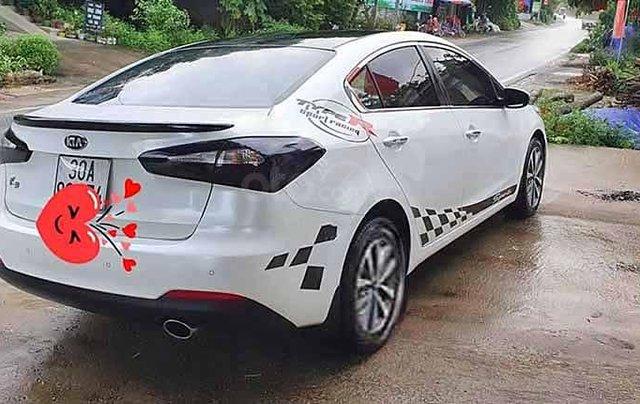 Cần bán xe Kia K3 sản xuất năm 2015, màu trắng, số tự động2