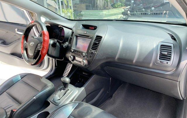 Bán Kia K3 1.6AT cuối 2014, màu trắng, một chủ xe cực đẹp, bao kiểm tra hãng giá rẻ5