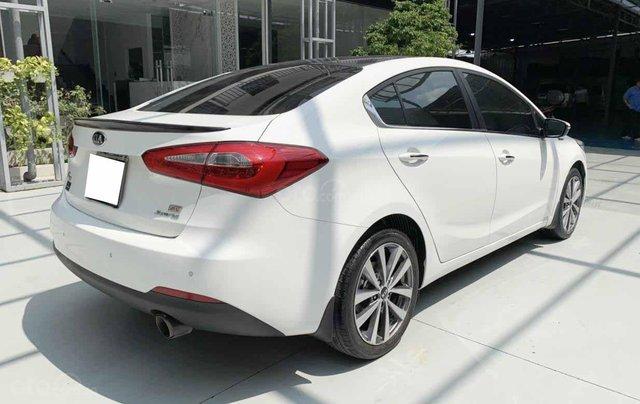 Bán Kia K3 1.6AT cuối 2014, màu trắng, một chủ xe cực đẹp, bao kiểm tra hãng giá rẻ9