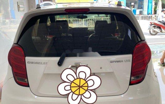 Bán Chevrolet Spark sản xuất 2015, màu trắng xe gia đình giá cạnh tranh10