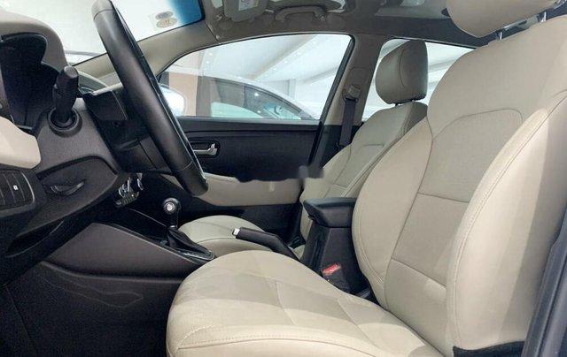 Bán ô tô Kia Rondo 2019 số tự động, màu xanh đá8