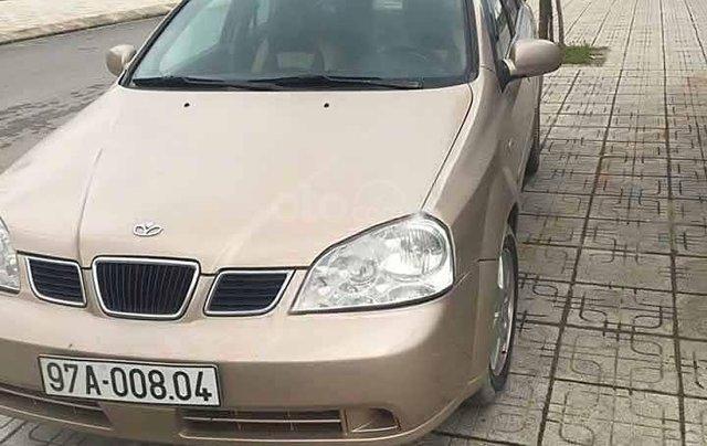 Cần bán gấp Daewoo Lacetti sản xuất 2004, màu vàng còn mới0