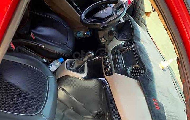 Cần bán lại xe Hyundai Grand i10 1.0 MT Base sản xuất năm 2014, màu đỏ 2