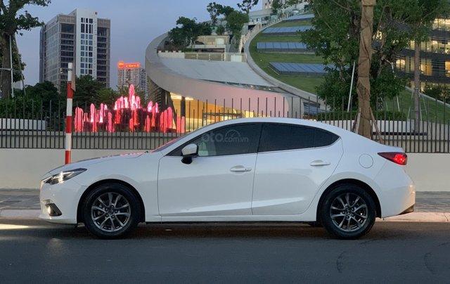 Ưu đãi giảm giá sâu với chiếc Mazda 3 màu trắng, đời 2015, xe còn mới, một đời chủ sử dụng1