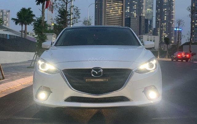 Ưu đãi giảm giá sâu với chiếc Mazda 3 màu trắng, đời 2015, xe còn mới, một đời chủ sử dụng0