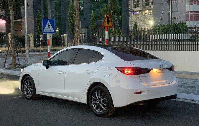Ưu đãi giảm giá sâu với chiếc Mazda 3 màu trắng, đời 2015, xe còn mới, một đời chủ sử dụng3