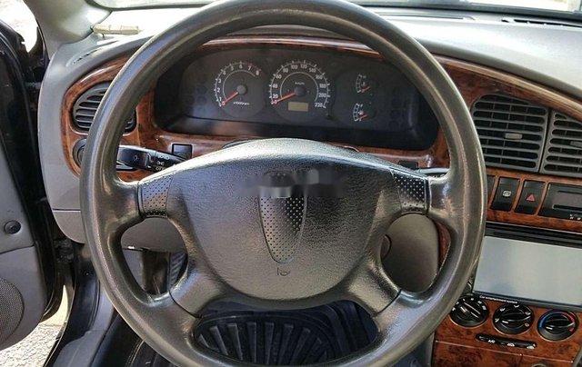 Cần bán Kia Spectra đời 2004, màu xanh lam, xe chính chủ, giá chỉ 97 triệu1