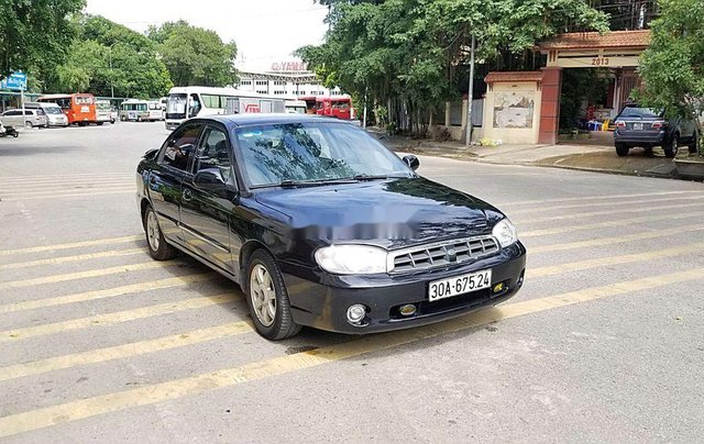Cần bán Kia Spectra đời 2004, màu xanh lam, xe chính chủ, giá chỉ 97 triệu0
