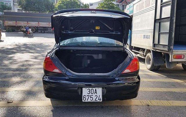 Cần bán Kia Spectra đời 2004, màu xanh lam, xe chính chủ, giá chỉ 97 triệu5