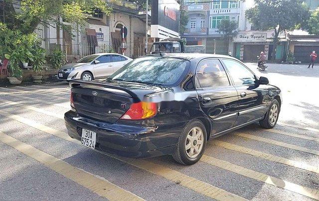 Cần bán Kia Spectra đời 2004, màu xanh lam, xe chính chủ, giá chỉ 97 triệu7