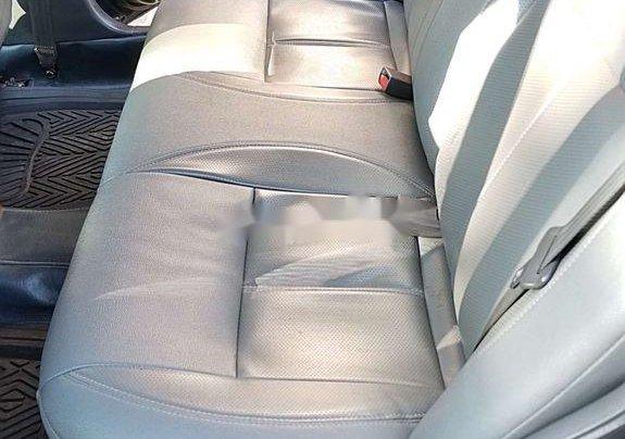 Cần bán Kia Spectra đời 2004, màu xanh lam, xe chính chủ, giá chỉ 97 triệu9