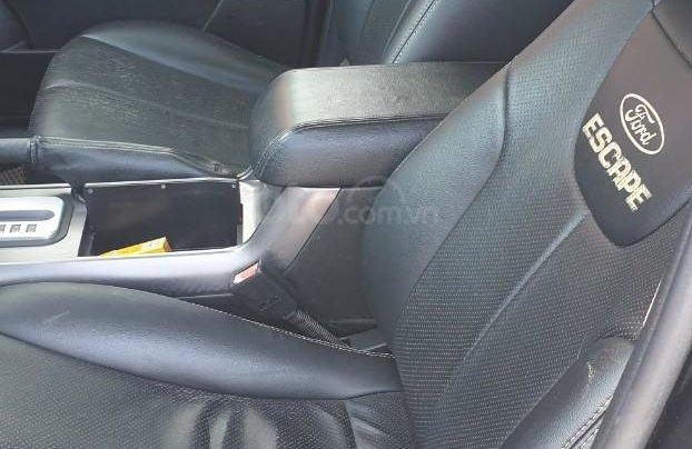 Bán xe Ford Escape số tự động màu đen, sản xuất 2011, trang bị đầy đủ các tiện ích của xe, nội ngoại thất còn rất đẹp1