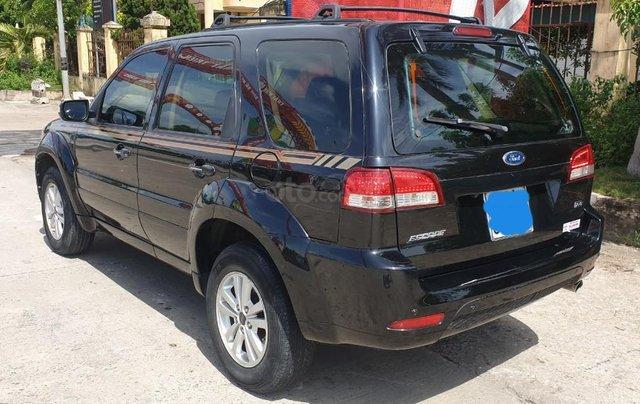 Bán xe Ford Escape số tự động màu đen, sản xuất 2011, trang bị đầy đủ các tiện ích của xe, nội ngoại thất còn rất đẹp3