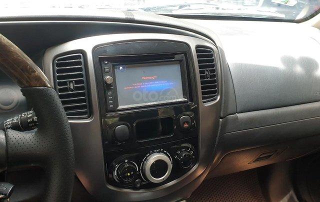 Bán xe Ford Escape số tự động màu đen, sản xuất 2011, trang bị đầy đủ các tiện ích của xe, nội ngoại thất còn rất đẹp5