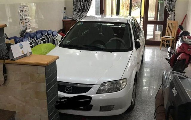 Bán Mazda 323 đời 2004, màu trắng, xe chính chủ1