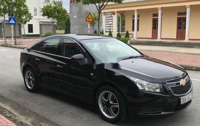 Cần bán gấp Chevrolet Cruze sản xuất 2010, màu đen, số sàn5