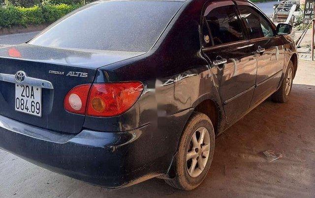 Bán Toyota Corolla sản xuất năm 2003, màu đen còn mới0