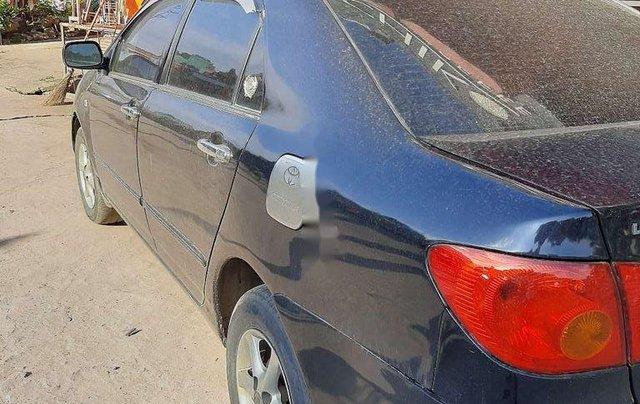 Bán Toyota Corolla sản xuất năm 2003, màu đen còn mới2