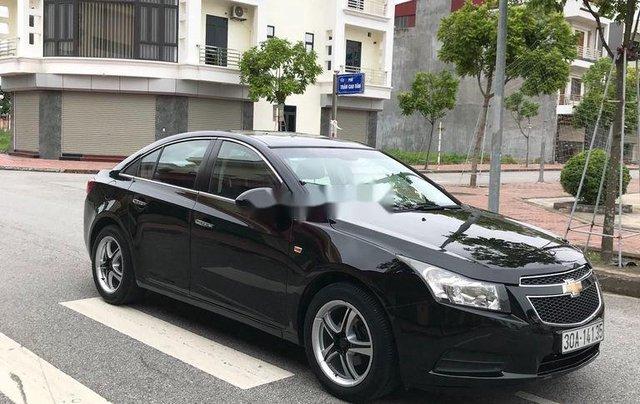 Cần bán gấp Chevrolet Cruze sản xuất 2010, màu đen, số sàn0