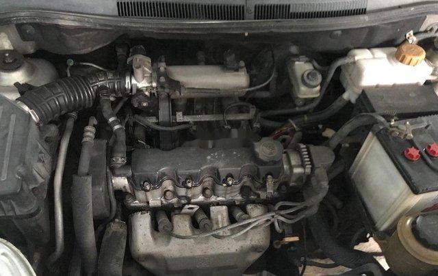 Bán xe Daewoo Gentra đời 2011, màu bạc số sàn8