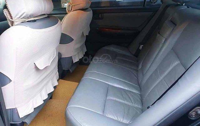 Bán xe Toyota Corolla Altis sản xuất năm 2004, màu đen còn mới, giá chỉ 238 triệu2