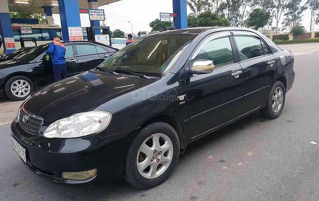 Bán xe Toyota Corolla Altis sản xuất năm 2004, màu đen còn mới, giá chỉ 238 triệu0