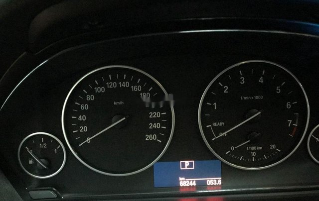 Cần bán BMW 320i sản xuất năm 2014, màu đen2