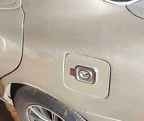 Cần bán lại xe Mazda 323 đời 2000, màu ghi vàng2