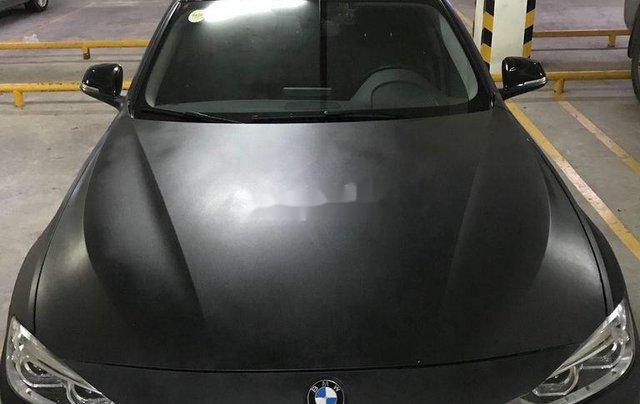 Cần bán BMW 320i sản xuất năm 2014, màu đen0