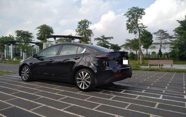 Bán xe Kia K3 1.6 AT năm sản xuất 2013, màu đen số tự động, 435tr0