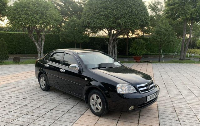 Gia đình bán Daewoo Lacetti sản xuất 2009, màu đen0