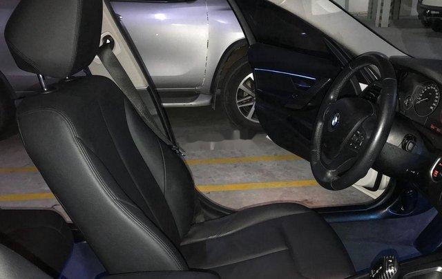 Cần bán BMW 320i sản xuất năm 2014, màu đen4
