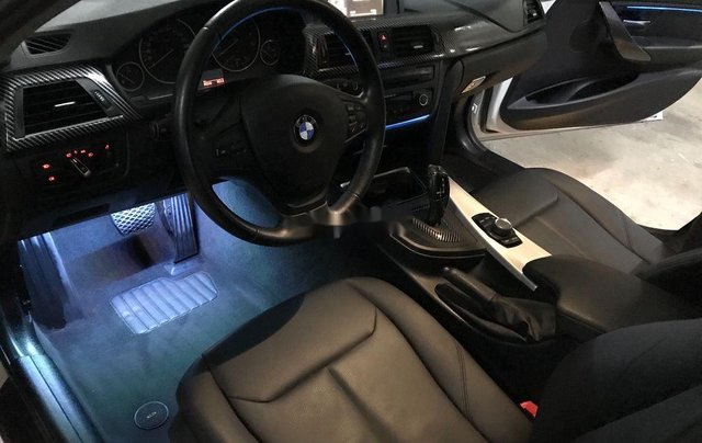 Cần bán BMW 320i sản xuất năm 2014, màu đen1