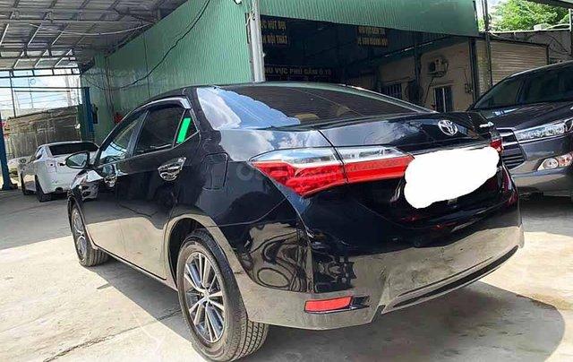 Cần bán xe Toyota Corolla Altis sản xuất 2019, màu đen còn mới giá cạnh tranh0