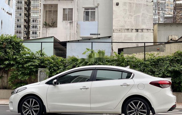 Cần bán Kia Cerato 2016, màu trắng chính chủ2