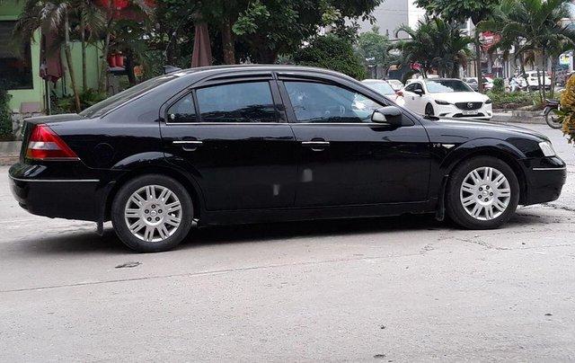Cần bán Ford Mondeo 2003, màu đen, xe gia đình0