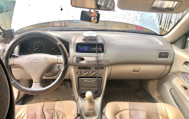 Cần bán Toyota Corolla năm sản xuất 2004, màu xám, xe nhập 3