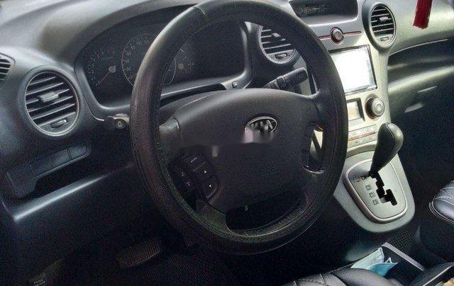 Bán ô tô Kia Carens năm sản xuất 2010, màu đen, 305 triệu2