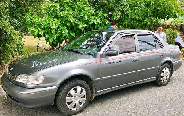 Cần bán Toyota Corolla năm sản xuất 2004, màu xám, xe nhập 2