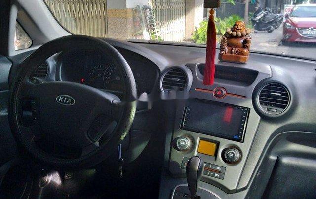 Bán ô tô Kia Carens năm sản xuất 2010, màu đen, 305 triệu3