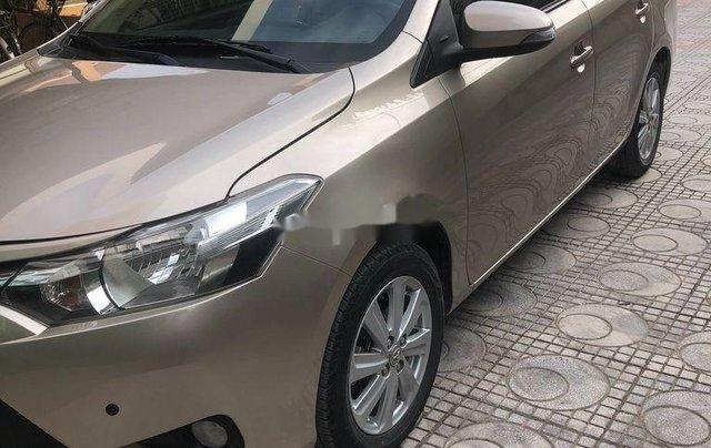Chính chủ bán Toyota Vios đời 2017, màu vàng cát0