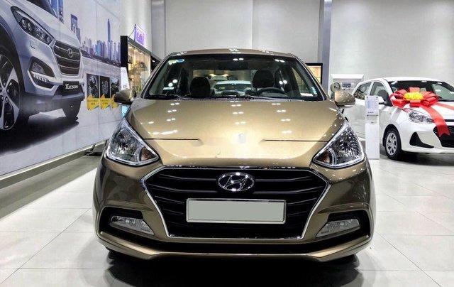 Cần bán Hyundai Grand i10 đời 2020, màu vàng cát0