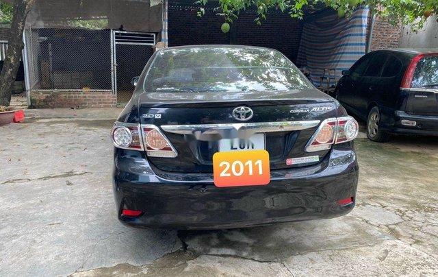 Bán Toyota Corolla Altis đời 2011, màu đen1