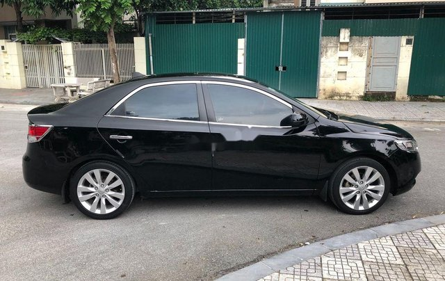 Chính chủ bán Kia Cerato đời 2011, màu đen, nhập khẩu2