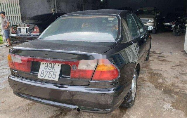 Bán Mazda 323 đời 2000, màu đen3