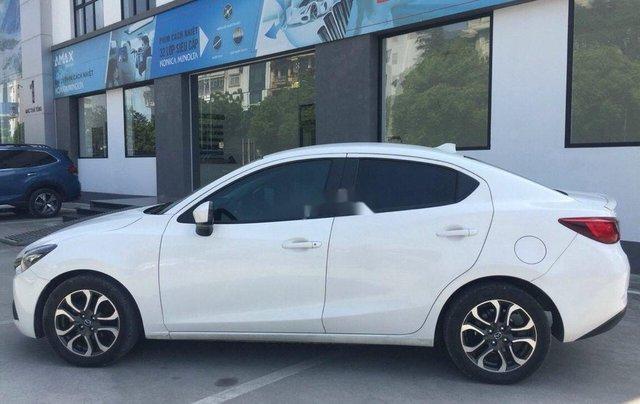 Cần bán lại xe Mazda 2 sản xuất 2016, màu trắng0