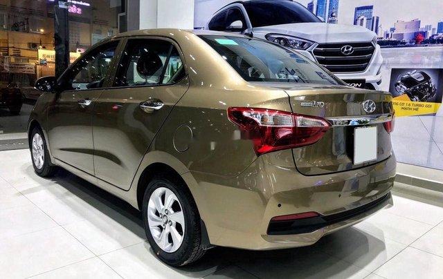 Cần bán Hyundai Grand i10 đời 2020, màu vàng cát1