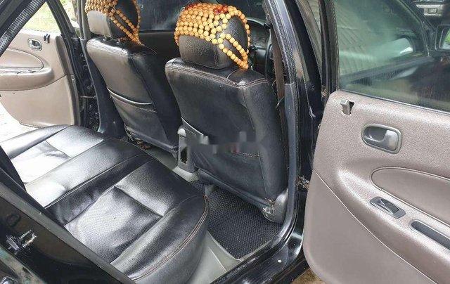 Bán Mazda 323 đời 2000, màu đen4